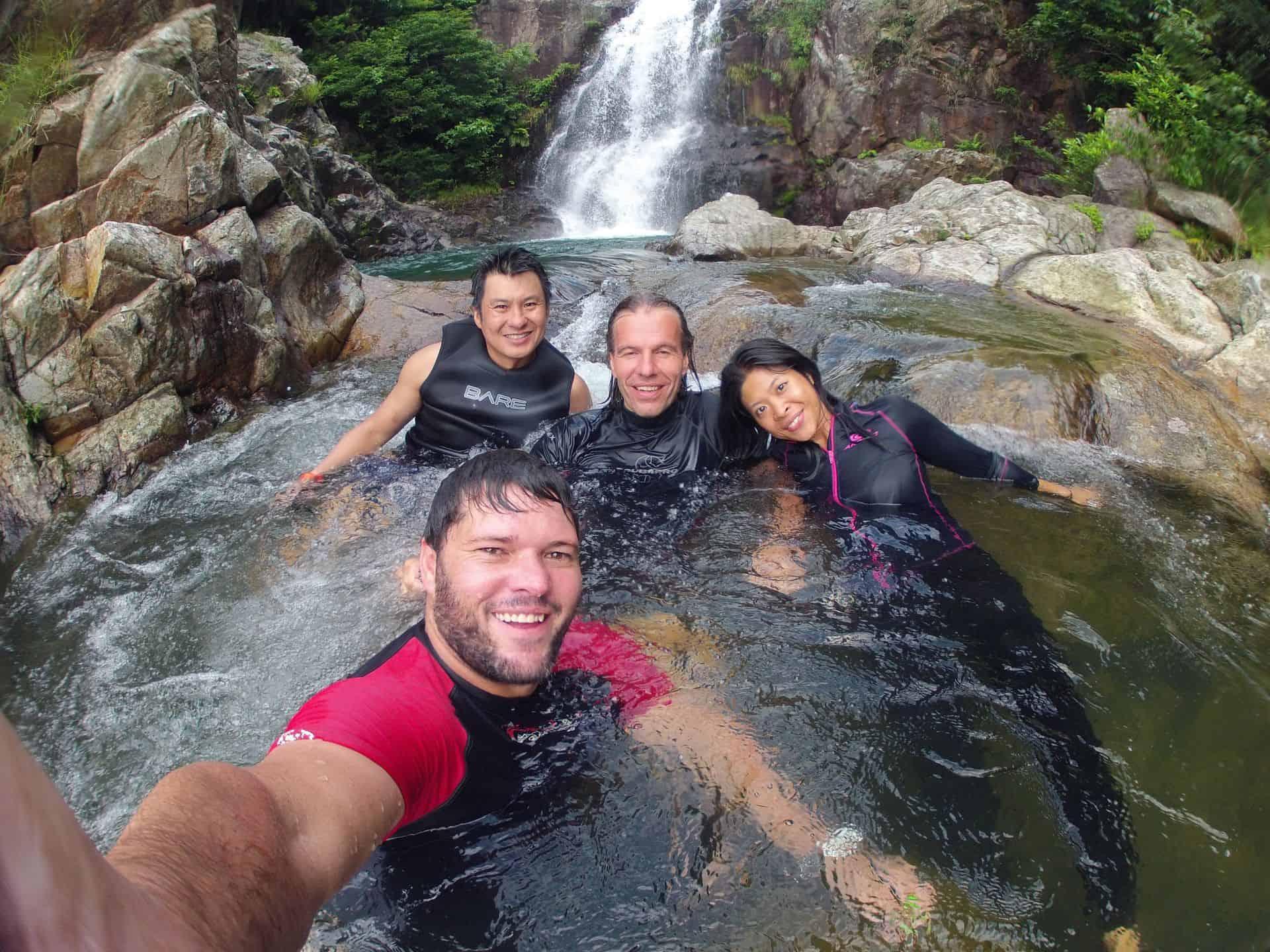 refresing swim in waterfall