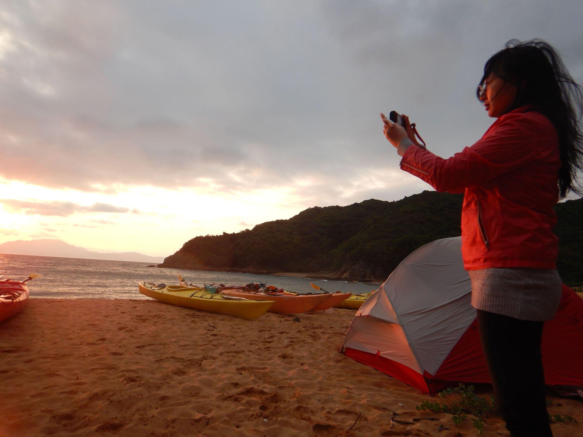 Sunset sea kayak camping tour
